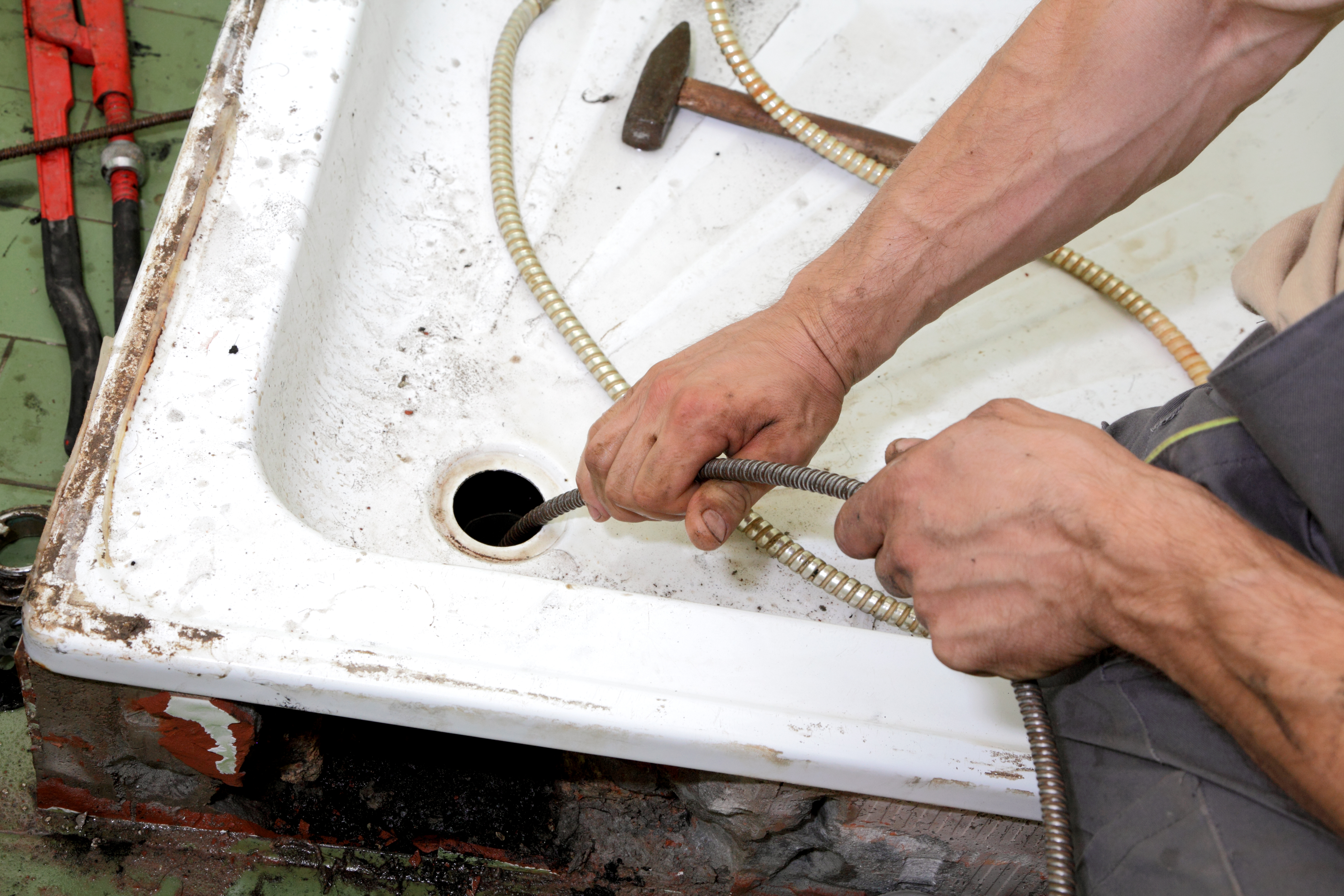 cleaning a clogged drain - d.i.y. or call a pro?